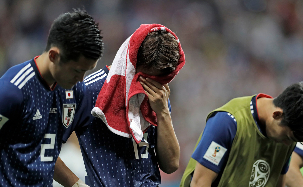 . Japan\'s disappointed Hiroki Sakai puts a shirt on his face after losing the round of 16 match between Belgium and Japan at the 2018 soccer World Cup in the Rostov Arena, in Rostov-on-Don, Russia, Monday, July 2, 2018. (AP Photo/Petr David Josek)
