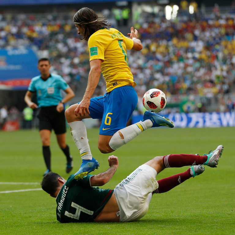 . Brazil\'s Filipe Luis jumps over Mexico\'s Rafael Marquez during the round of 16 match between Brazil and Mexico at the 2018 soccer World Cup in the Samara Arena, in Samara, Russia, Monday, July 2, 2018. (AP Photo/Eduardo Verdugo)