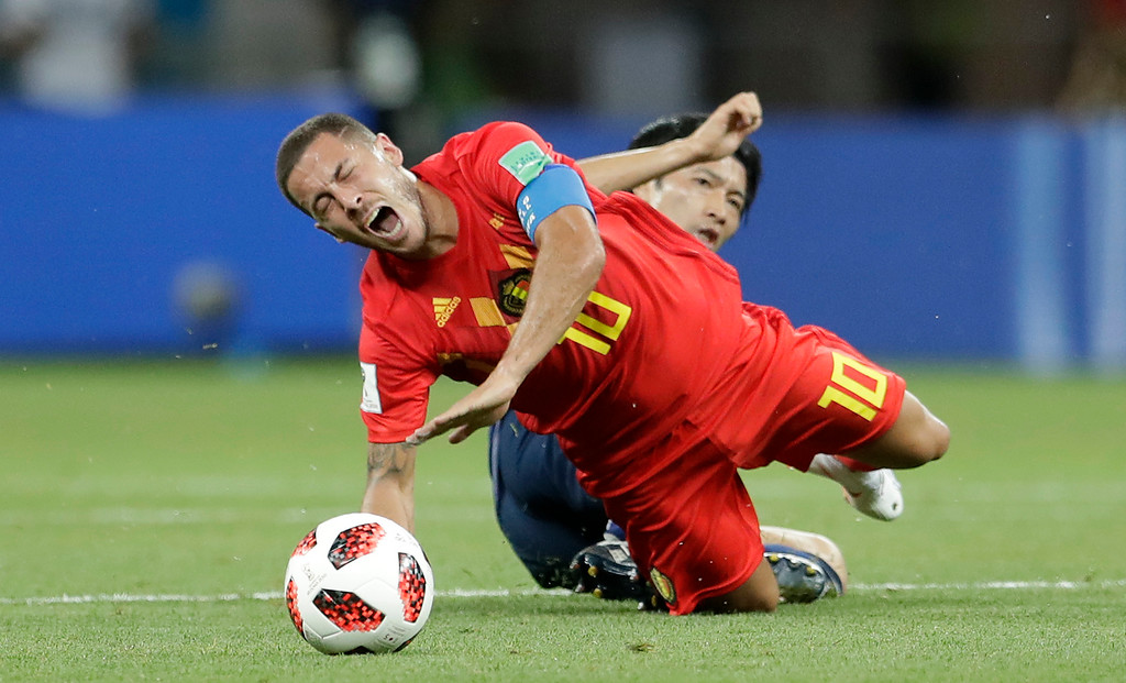. Belgium\'s Eden Hazard is fouled by Japan\'s Gaku Shibasaki during the round of 16 match between Belgium and Japan at the 2018 soccer World Cup in the Rostov Arena, in Rostov-on-Don, Russia, Monday, July 2, 2018. (AP Photo/Petr David Josek)