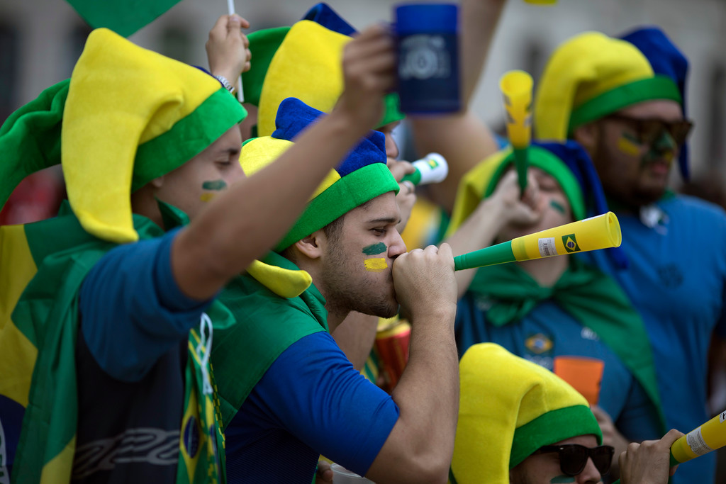 . Brazil soccer fans cheer before the start of a live broadcast of a 2018 Russia World Cup soccer match between Brazil and Mexico in Rio de Janeiro, Brazil, Monday, July 2, 2018. (AP Photo/Leo Correa)