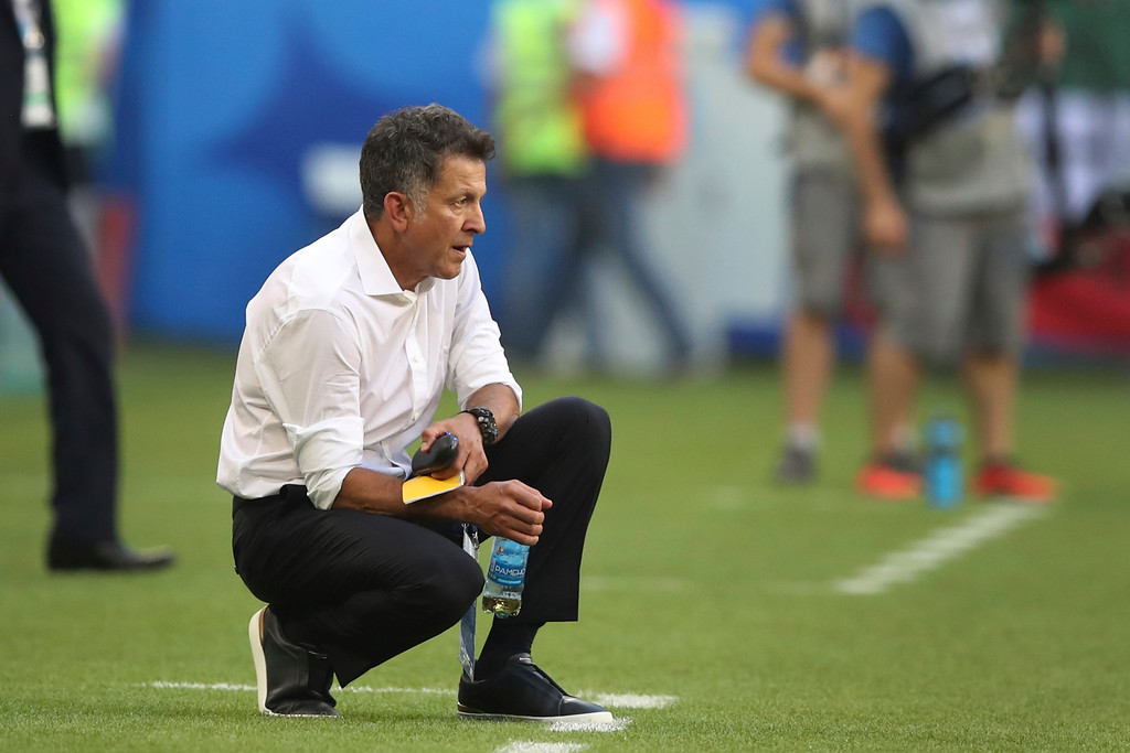 . Mexico head coach Juan Carlos Osorio follows the action during the round of 16 match between Brazil and Mexico at the 2018 soccer World Cup in the Samara Arena, in Samara, Russia, Monday, July 2, 2018. (AP Photo/Thanassis Stavrakis)