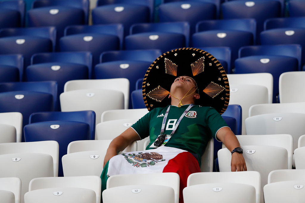 . A fan of Mexico sits in the stands after the round of 16 match between Brazil and Mexico at the 2018 soccer World Cup in the Samara Arena, in Samara, Russia, Monday, July 2, 2018. Mexico lost 0-2. (AP Photo/Eduardo Verdugo)