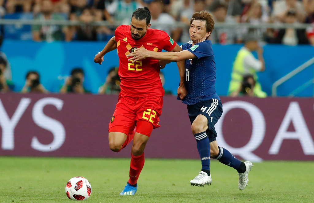 . Belgium\'s Nacer Chadli, Japan\'s Japan\'s Takashi Inui during the round of 16 match between Belgium and Japan at the 2018 soccer World Cup in the Rostov Arena, in Rostov-on-Don, Russia, Monday, July 2, 2018. (AP Photo/Rebecca Blackwell)