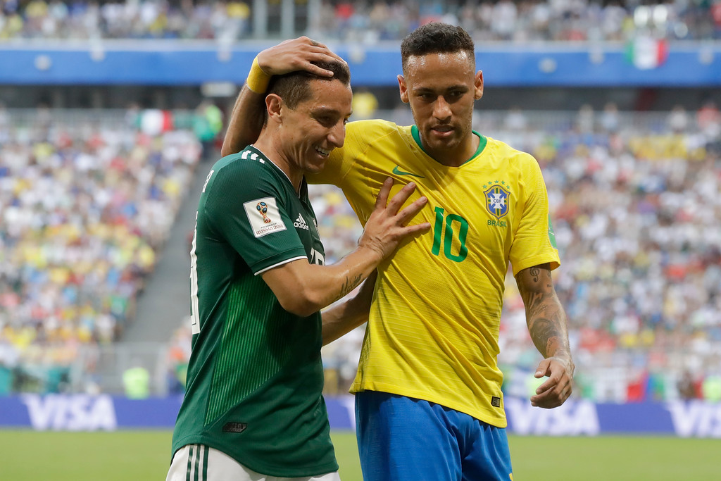 . Brazil\'s Neymar, right, and Mexico\'s Andres Guardado, left, talk during the round of 16 match between Brazil and Mexico at the 2018 soccer World Cup in the Samara Arena, in Samara, Russia, Monday, July 2, 2018. (AP Photo/Andre Penner)