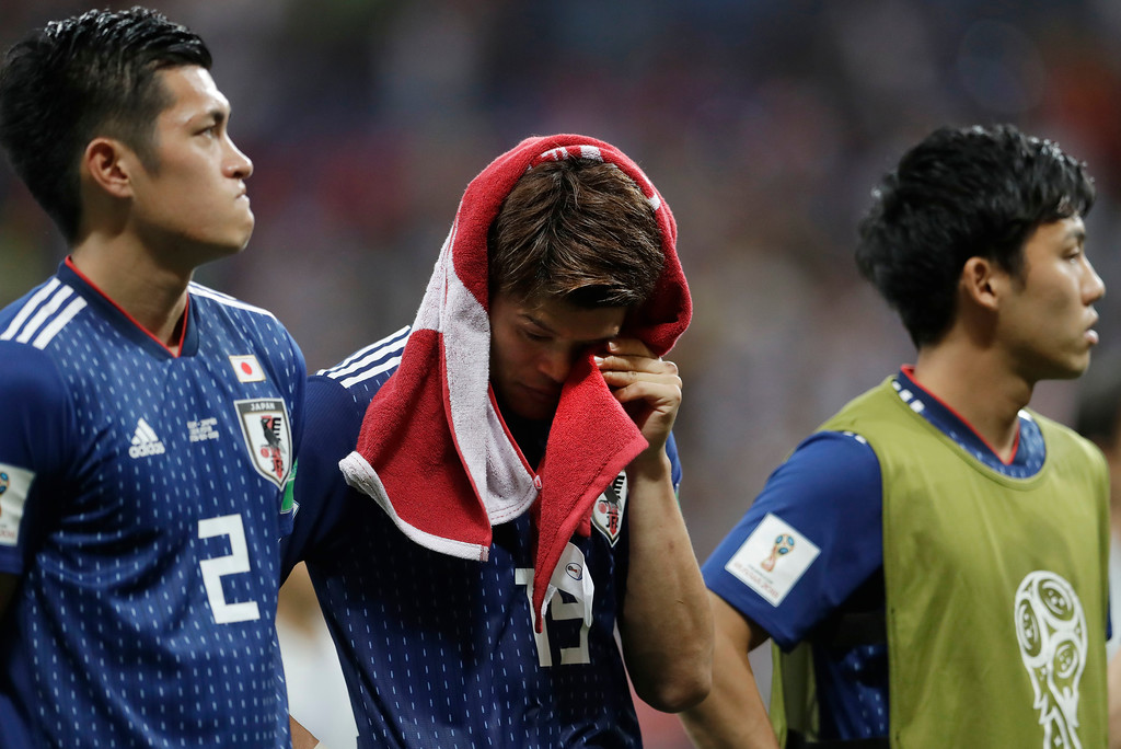 . Japan\'s disappointed Hiroki Sakai drys a tear with a shirt after losing the round of 16 match between Belgium and Japan at the 2018 soccer World Cup in the Rostov Arena, in Rostov-on-Don, Russia, Monday, July 2, 2018. (AP Photo/Petr David Josek)