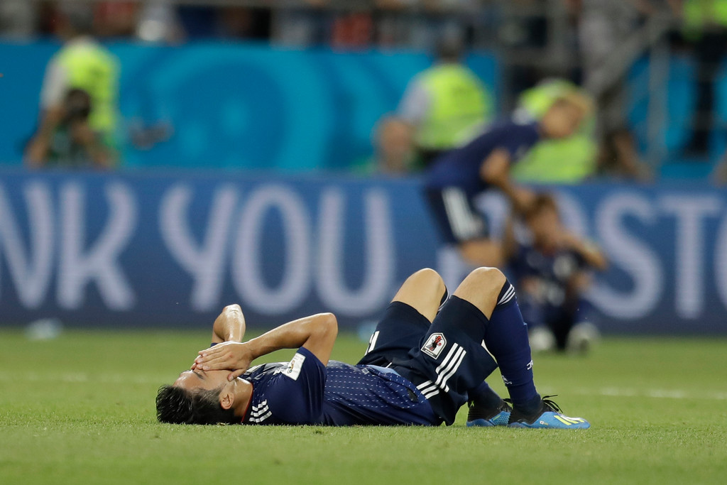 . Japan\'s Shinji Kagawa lies on the pitch at the end of the round of 16 match between Belgium and Japan at the 2018 soccer World Cup in the Rostov Arena, in Rostov-on-Don, Russia, Monday, July 2, 2018. Belgium won 3-2. (AP Photo/Natacha Pisarenko)
