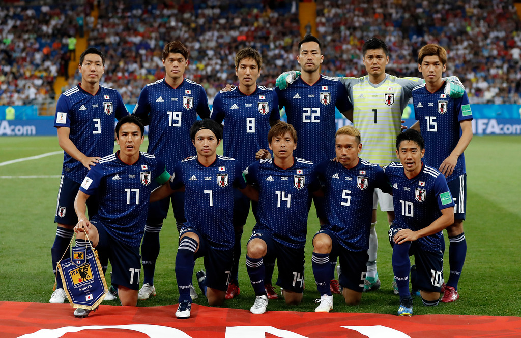 . Japan\'s team stands for the team photo prior the round of 16 match between Belgium and Japan at the 2018 soccer World Cup in the Rostov Arena, in Rostov-on-Don, Russia, Monday, July 2, 2018. (AP Photo/Petr David Josek)