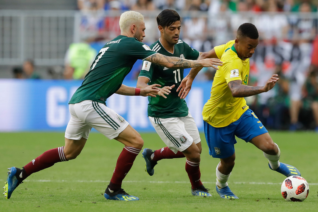 . Brazil\'s Gabriel Jesus, right, vies for the ball with Mexico\'s Miguel Layun, left, and Mexico\'s Carlos Vela, center, during the round of 16 match between Brazil and Mexico at the 2018 soccer World Cup in the Samara Arena, in Samara, Russia, Monday, July 2, 2018. (AP Photo/Andre Penner)