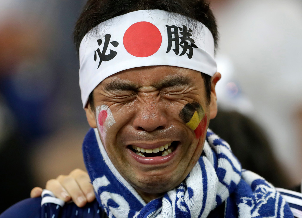 . A Japan supporters cries after losing the round of 16 match between Belgium and Japan at the 2018 soccer World Cup in the Rostov Arena, in Rostov-on-Don, Russia, Monday, July 2, 2018. (AP Photo/Petr David Josek)