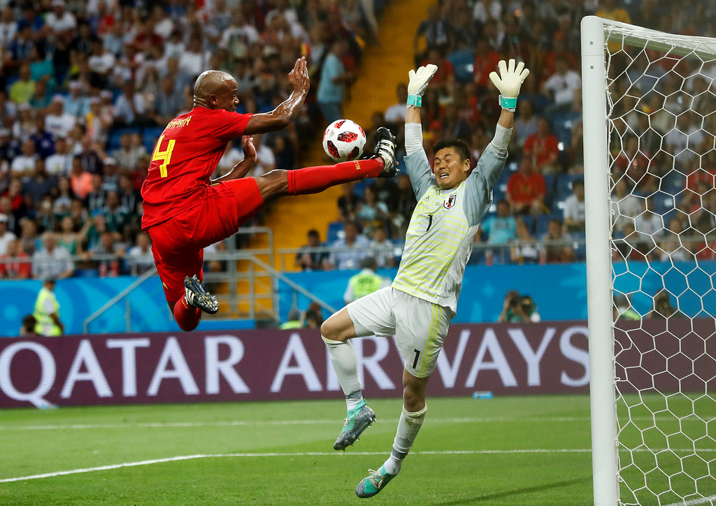 . Belgium\'s Vincent Kompany jumps for the ball in front of Japan goalkeeper Eiji Kawashima during the round of 16 match between Belgium and Japan at the 2018 soccer World Cup in the Rostov Arena, in Rostov-on-Don, Russia, Monday, July 2, 2018. (AP Photo/Petr David Josek)