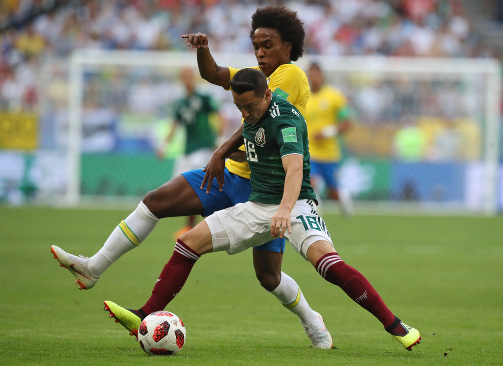 . Mexico\'s Andres Guardado, right, vies for the ball with Brazil\'s Willian during the round of 16 match between Brazil and Mexico at the 2018 soccer World Cup in the Samara Arena, in Samara, Russia, Monday, July 2, 2018. (AP Photo/Thanassis Stavrakis)