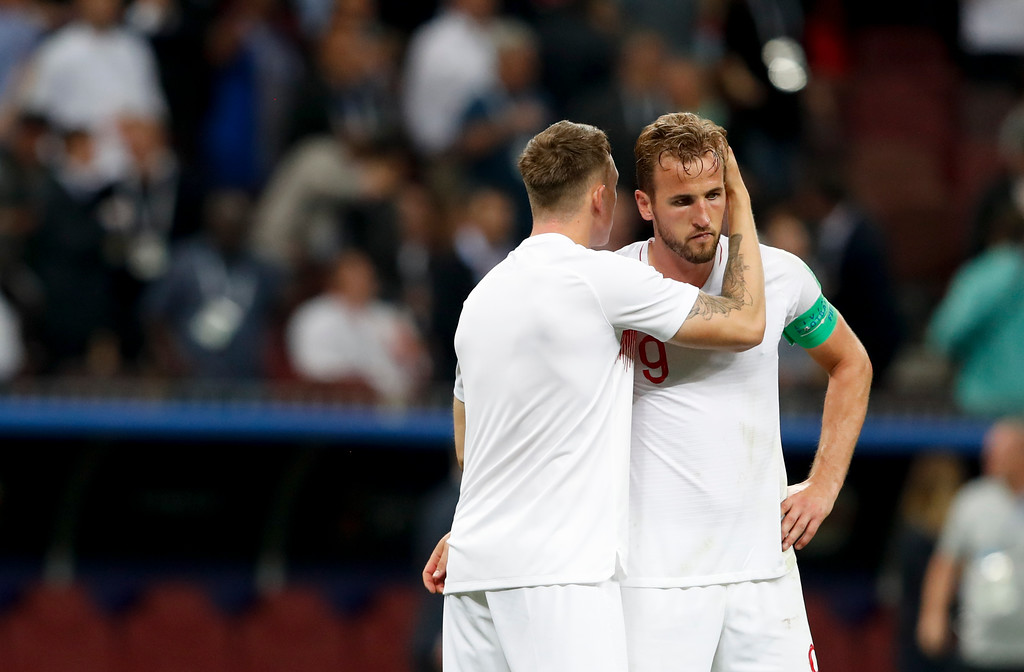 . England\'s Harry Kane, right, and England\'s Eric Dier react at the end of the semifinal match between Croatia and England at the 2018 soccer World Cup in the Luzhniki Stadium in Moscow, Russia, Wednesday, July 11, 2018. (AP Photo/Rebecca Blackwell)