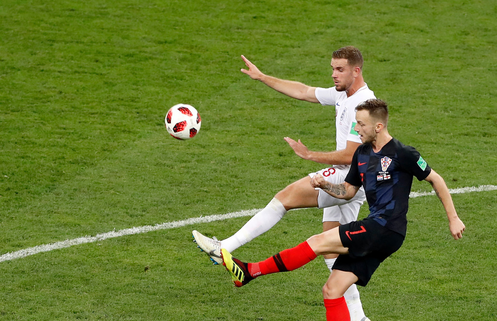 . Croatia\'s Ivan Rakitic, front, duels for the ball with England\'s Jordan Henderson during the semifinal match between Croatia and England at the 2018 soccer World Cup in the Luzhniki Stadium in Moscow, Russia, Wednesday, July 11, 2018. (AP Photo/Darko Bandic)