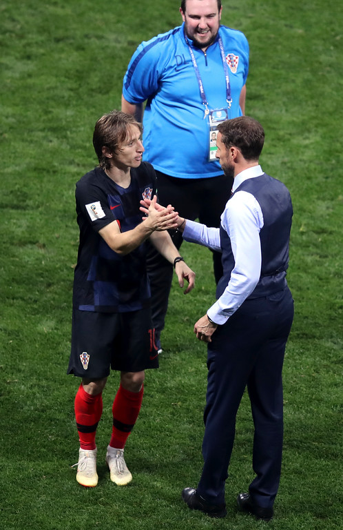 . Croatia\'s Luka Modric shakes hands with England head coach Gareth Southgate, right, at the end of the semifinal match between Croatia and England at the 2018 soccer World Cup in the Luzhniki Stadium in Moscow, Russia, Wednesday, July 11, 2018. (AP Photo/Thanassis Stavrakis)