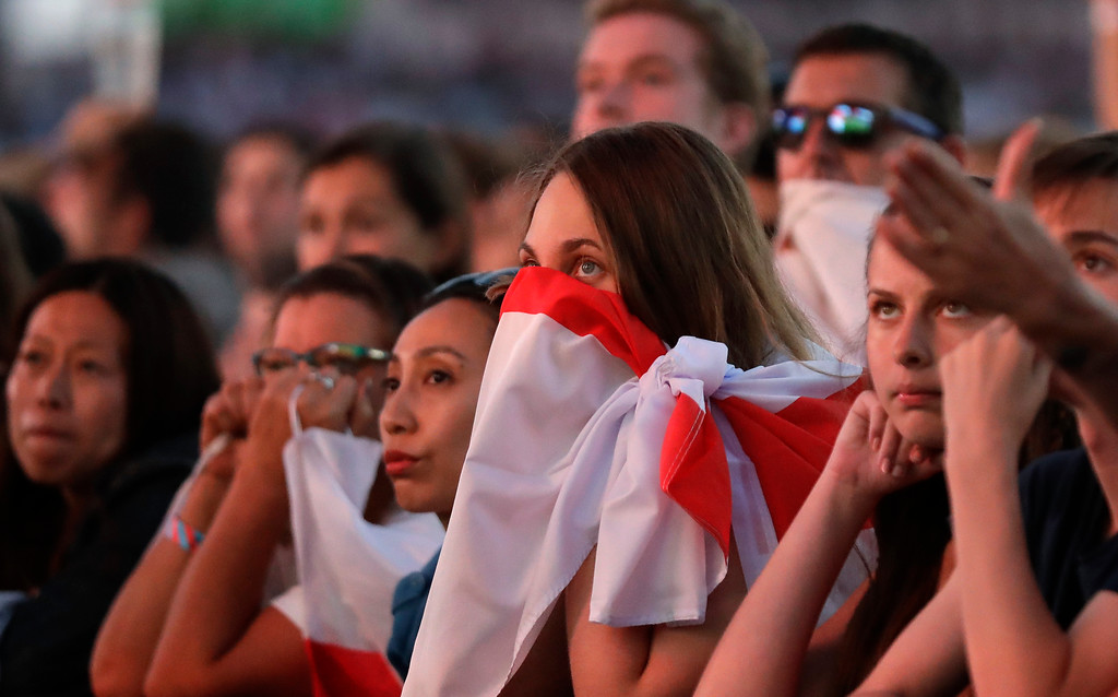 . England soccer fans react as they watch a live broadcast on a big screen of the semifinal match between Croatia and England at the 2018 soccer World Cup, in Hyde Park, London, Wednesday, July 11, 2018. (AP Photo/Matt Dunham)
