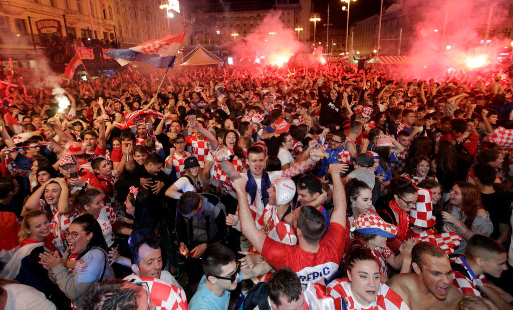 . Croatian fans celebrate at the end of the semifinal match between Croatia and England, in Zagreb, Croatia, Wednesday, July 11, 2018. (AP Photo/Nikola Solic)