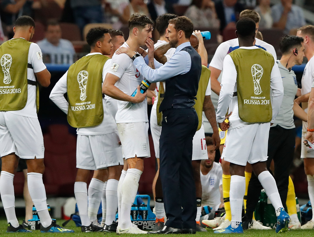 . England head coach Gareth Southgate, right, talks to England\'s John Stones during the semifinal match between Croatia and England at the 2018 soccer World Cup in the Luzhniki Stadium in Moscow, Russia, Wednesday, July 11, 2018. (AP Photo/Rebecca Blackwell)