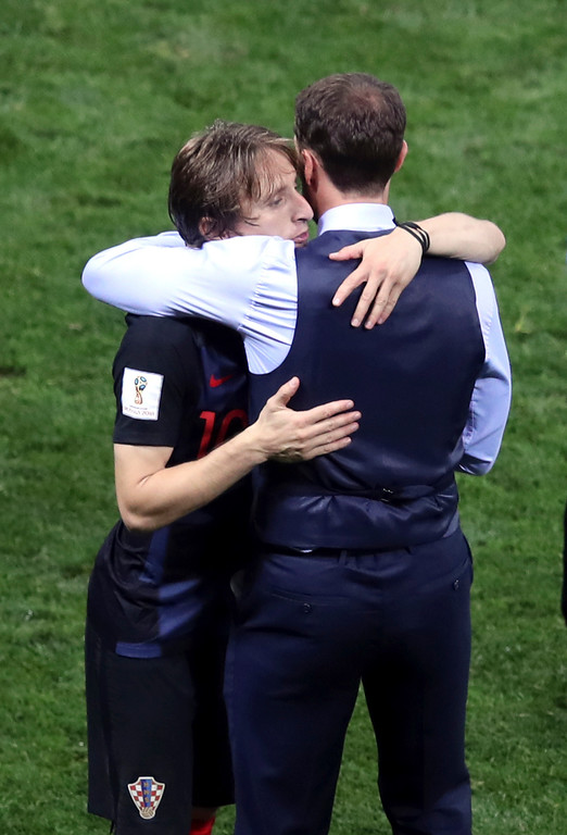 . Croatia\'s Luka Modric hugs England head coach Gareth Southgate, right, at the end of the semifinal match between Croatia and England at the 2018 soccer World Cup in the Luzhniki Stadium in Moscow, Russia, Wednesday, July 11, 2018. (AP Photo/Thanassis Stavrakis)