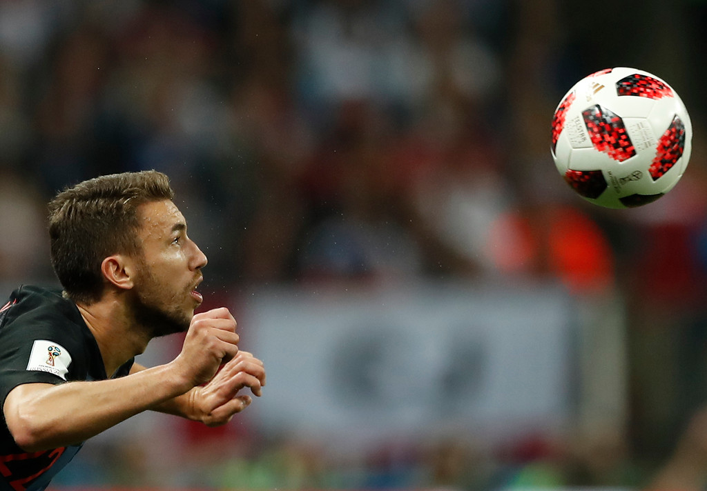 . Croatia\'s Josip Pivaric heads the ball during the semifinal match between Croatia and England at the 2018 soccer World Cup in the Luzhniki Stadium in, Moscow, Russia, Wednesday, July 11, 2018. (AP Photo/Alastair Grant)