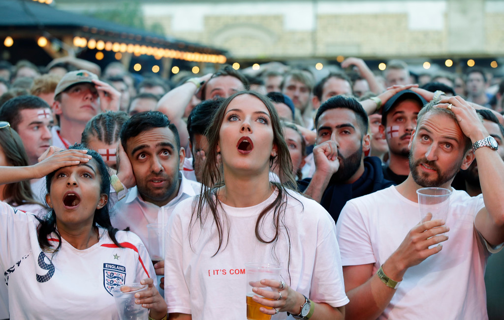 . England soccer fans react after Croatia scored his side\'s first goal as they watch a live broadcast on a big screen of the semifinal match between Croatia and England at the 2018 soccer World Cup, in Flat Iron Square, south London, Wednesday, July 11, 2018. (AP Photo/Luca Bruno)