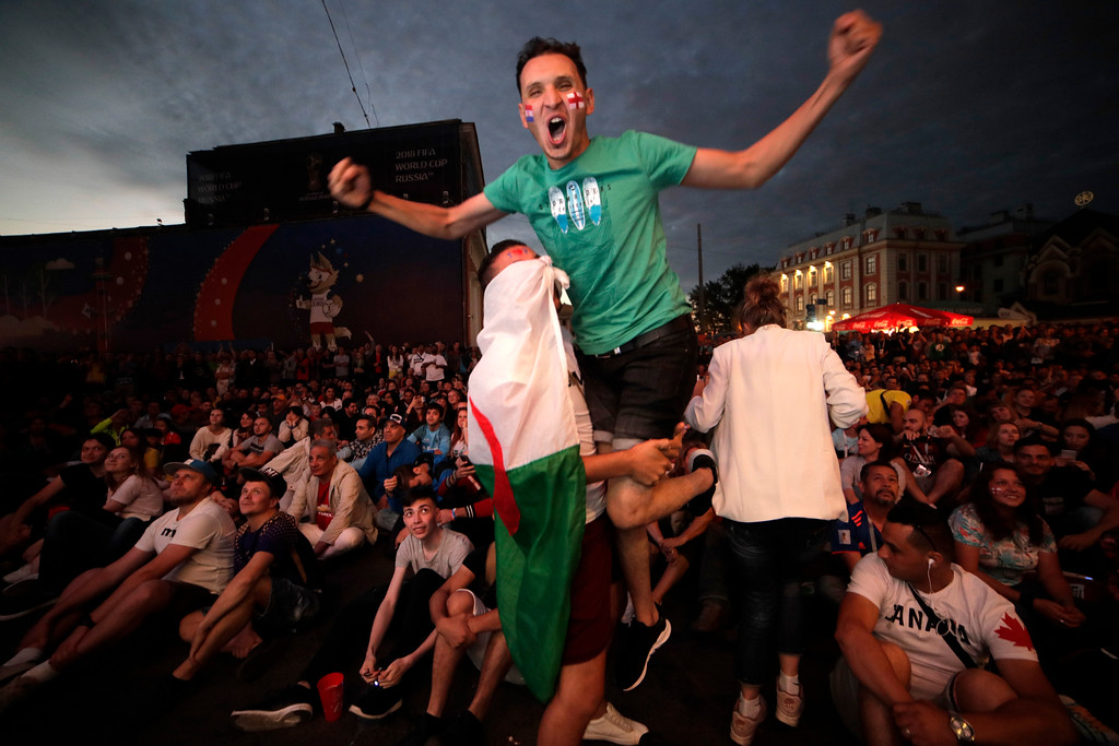 . Fans from Algeria celebrate Croatia\'s second goal as they watch the semifinal match between Croatia and England at the 2018 soccer World Cup at a fan zone in, St.Petersburg, Russia, Thursday, July 12, 2018. (AP Photo/Dmitri Lovetsky)
