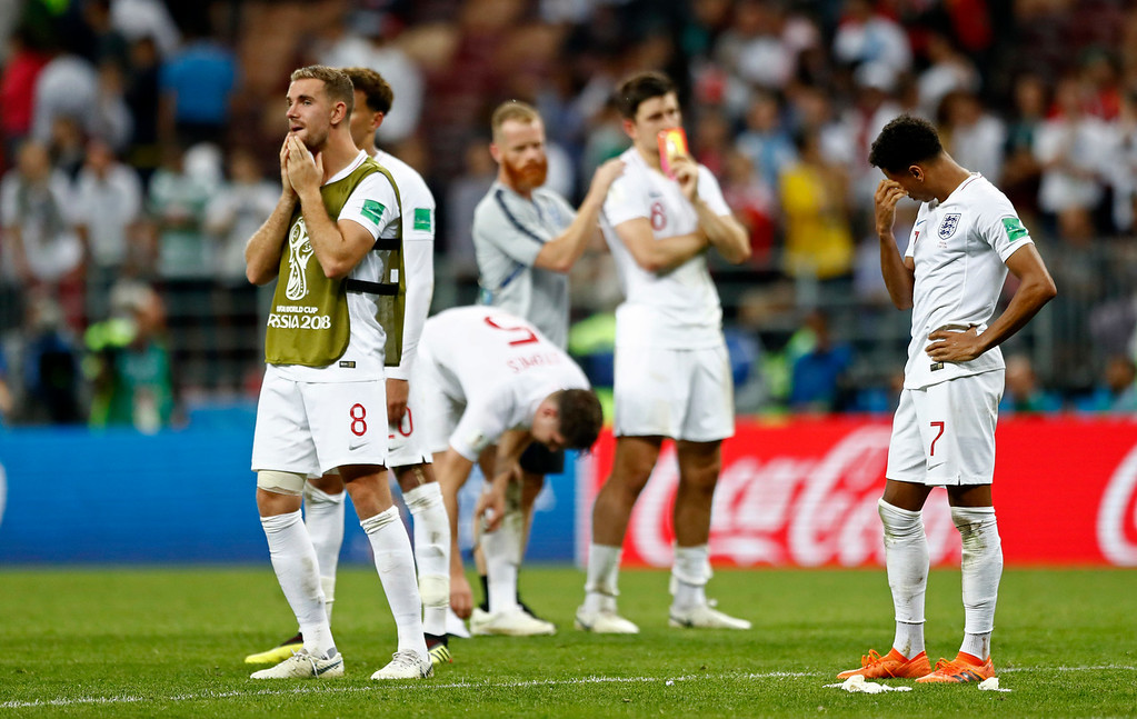 . England\'s Jesse Lingard, right, and England\'s Jordan Henderson, left, stand on the pitch disappointed after losing the semifinal match between Croatia and England at the 2018 soccer World Cup in the Luzhniki Stadium in Moscow, Russia, Wednesday, July 11, 2018. (AP Photo/Matthias Schrader)