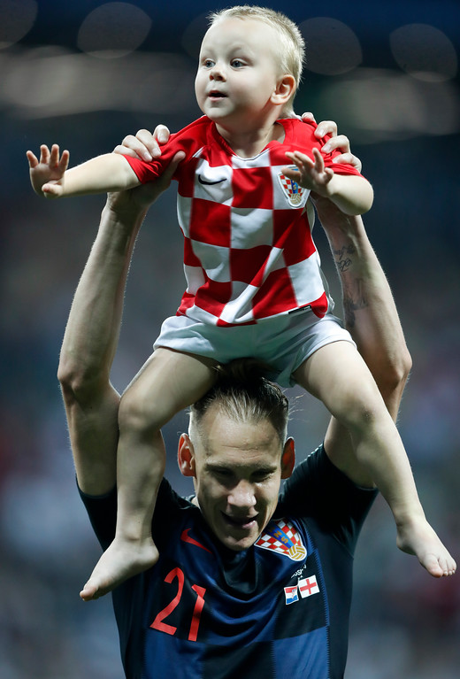 . Croatia\'s Domagoj Vida celebrates with a boy on his shoulders after his team advanced to the final after the semifinal match between Croatia and England at the 2018 soccer World Cup in the Luzhniki Stadium in Moscow, Russia, Wednesday, July 11, 2018. (AP Photo/Frank Augstein)