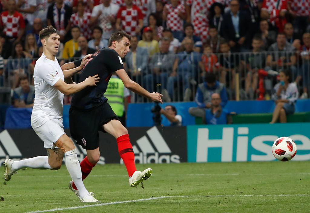 . Croatia\'s Mario Mandzukic scores his side\' second goal during the semifinal match between Croatia and England at the 2018 soccer World Cup in the Luzhniki Stadium in, Moscow, Russia, Wednesday, July 11, 2018. (AP Photo/Alastair Grant)