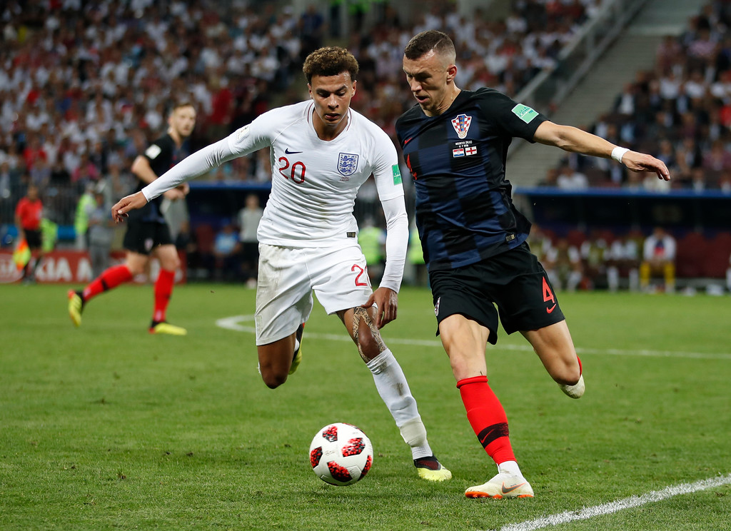 . Croatia\'s Ivan Perisic, right, challenges for the ball England\'s Dele Alli, left, during the semifinal match between Croatia and England at the 2018 soccer World Cup in the Luzhniki Stadium in Moscow, Russia, Wednesday, July 11, 2018. (AP Photo/Francisco Seco)