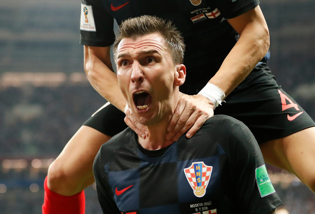 . Croatia\'s Mario Mandzukic celebrates after scoring his side\'s second goal during the semifinal match between Croatia and England at the 2018 soccer World Cup in the Luzhniki Stadium in Moscow, Russia, Wednesday, July 11, 2018. (AP Photo/Frank Augstein)