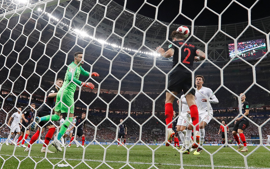 . Croatia\'s Sime Vrsaljko clears a header from England\'s John Stones off the line during the semifinal match between Croatia and England at the 2018 soccer World Cup in the Luzhniki Stadium in Moscow, Russia, Wednesday, July 11, 2018. (AP Photo/Frank Augstein)