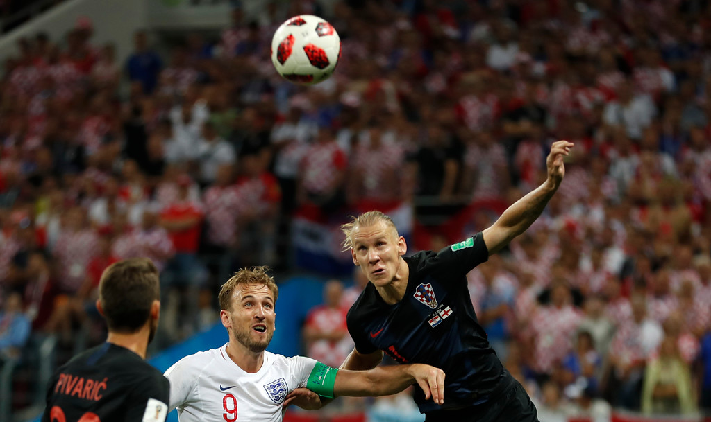 . Croatia\'s Josip Pivaric, left, and Croatia\'s Domagoj Vida, right, challenge for the ball England\'s Harry Kane, center, during the semifinal match between Croatia and England at the 2018 soccer World Cup in the Luzhniki Stadium in Moscow, Russia, Wednesday, July 11, 2018. (AP Photo/Francisco Seco)
