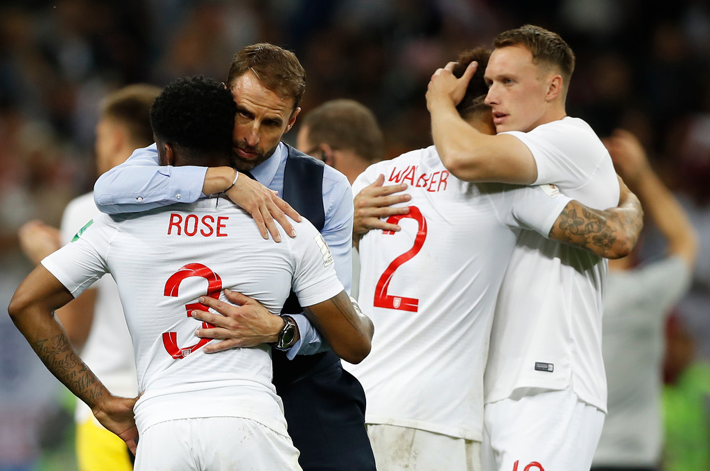 . England head coach Gareth Southgate, 2nd left, comforts England\'s Danny Rose, left, after loosing the semifinal match between Croatia and England at the 2018 soccer World Cup in the Luzhniki Stadium in Moscow, Russia, Wednesday, July 11, 2018. (AP Photo/Francisco Seco)