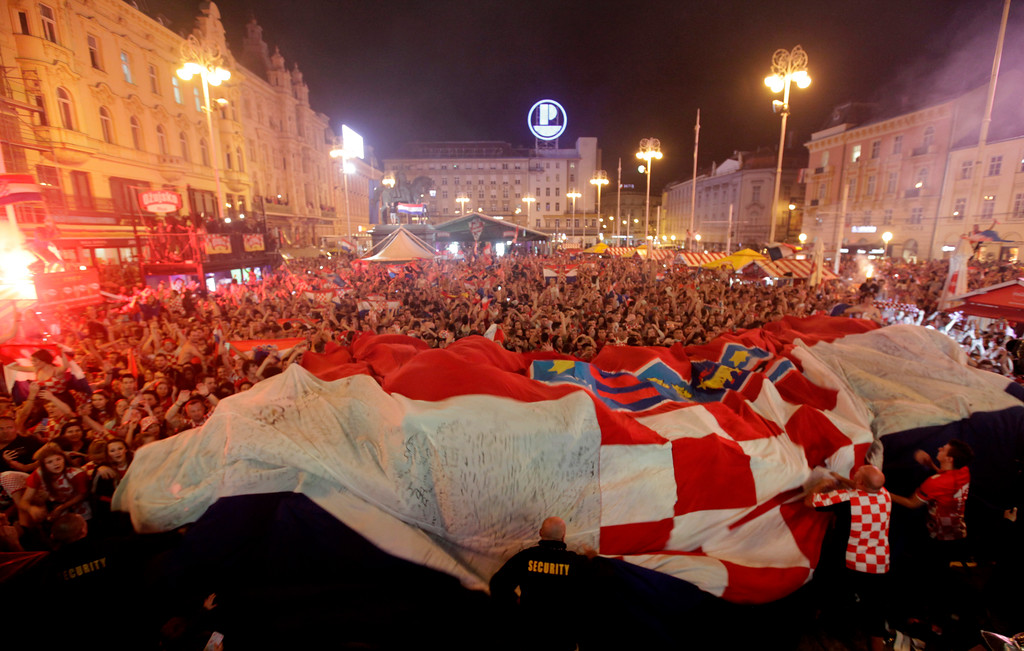 . Croatia fans celebrate at the end of the semifinal match between Croatia and England, in Zagreb, Croatia, Wednesday, July 11, 2018. (AP Photo/Nikola Solic)