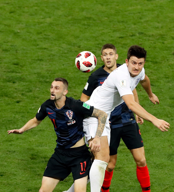 . England\'s Harry Maguire, right, jumps for the ball with Croatia\'s Marcelo Brozovic, left, during the semifinal match between Croatia and England at the 2018 soccer World Cup in the Luzhniki Stadium in Moscow, Russia, Wednesday, July 11, 2018. (AP Photo/Darko Bandic)