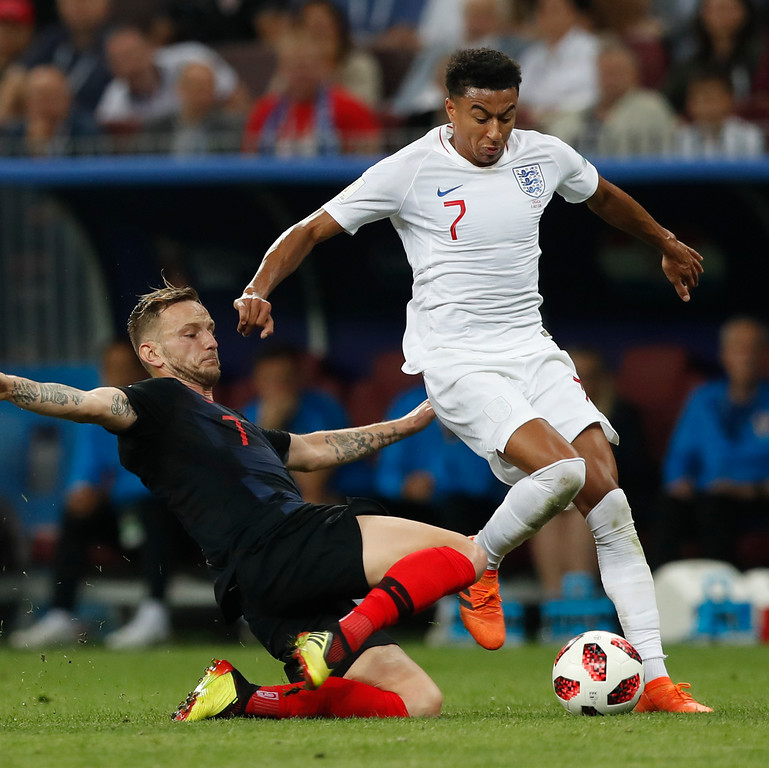 . Croatia\'s Ivan Rakitic, left, and England\'s Jesse Lingard challenge for the ball during the semifinal match between Croatia and England at the 2018 soccer World Cup in the Luzhniki Stadium in, Moscow, Russia, Wednesday, July 11, 2018. (AP Photo/Alastair Grant)
