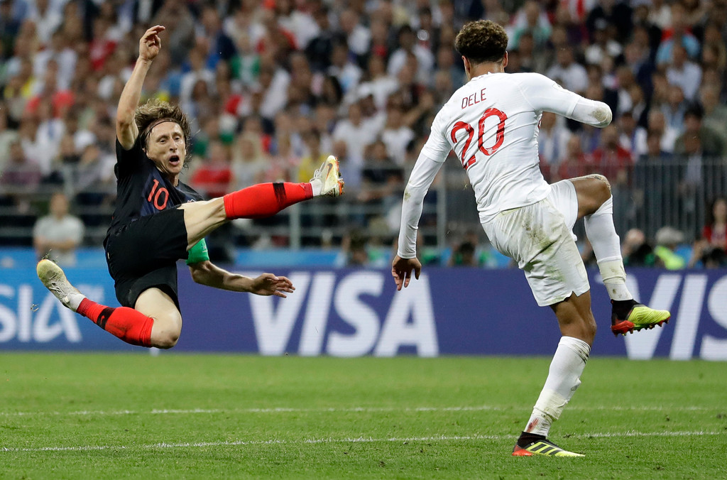 . Croatia\'s Luka Modric, left, challenges with England\'s Dele Alli during the semifinal match between Croatia and England at the 2018 soccer World Cup in the Luzhniki Stadium in Moscow, Russia, Wednesday, July 11, 2018. (AP Photo/Matthias Schrader)