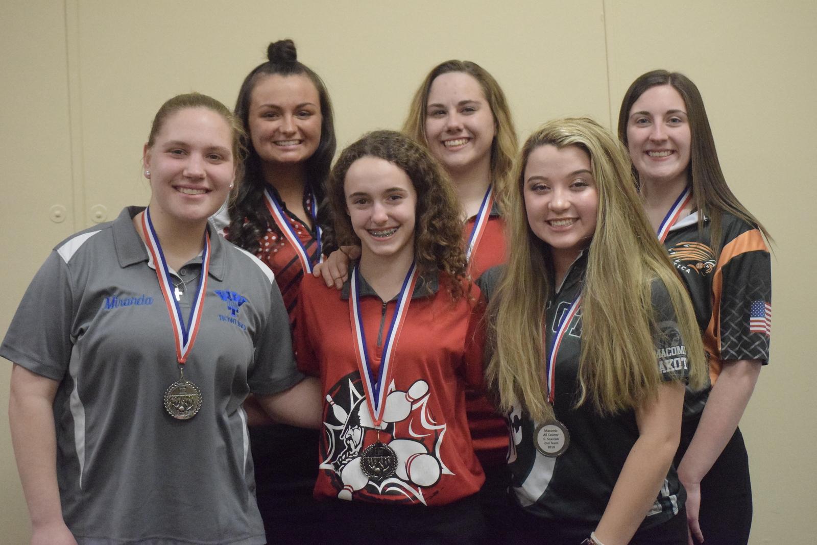 All-Macomb County Second Team, from left, Miranda Walker of Warren Woods-Tower, Danielle Seaman of Anchor Bay, Danella DeCruydt of Lake Shore, Jessica Ludwick of Lake Shore, Carly Scanlon of Dakota and Sydney Clark of Utica.