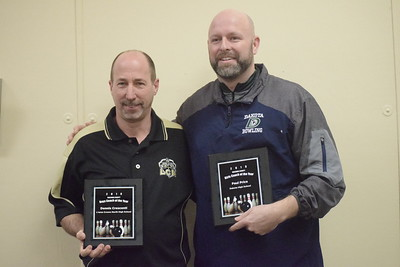 Dennis Crescenti, left, of L'Anse Creuse North was named Macomb County boys Coach of the Year and Paul Price of Dakota the girls Coach of the Year. Crescenti coached the Crusaders with Phil Pordon.