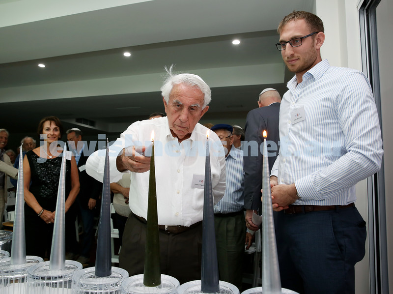 MDA Cocktail Party to honour Robert Magid as new patron. Harry Triguboff (left) lights the Menorah with Rabbi Benji Levy. Pic Noel Kessel.