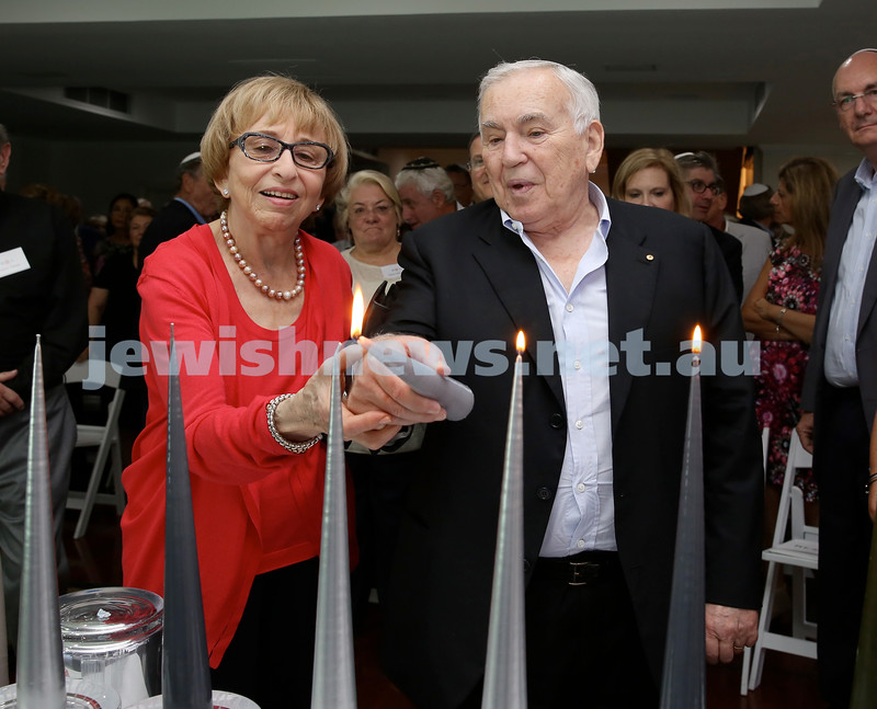 MDA Cocktail Party to honour Robert Magid as new patron. Gerder & Joseph Brender light the Menorah. Pic Noel Kessel.