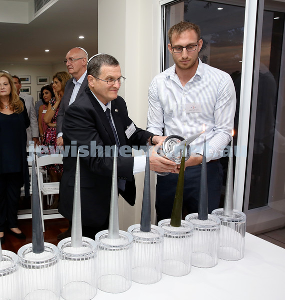 MDA Cocktail Party to honour Robert Magid as new patron. Israeli Ambassador Shmuel Ben Shmuel (left) and Rabbi Benji Levy light the Menorah.