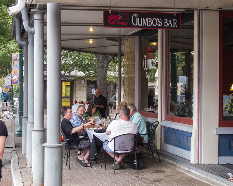 Gumbo's across from our booth. Also a nice upstairs bar & balcony seating.