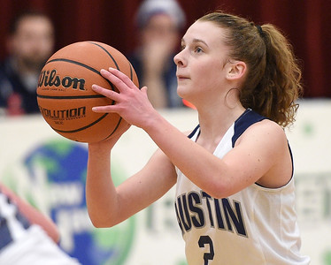 Carmela Shorkey (2) of Austin Catholic puts up a shot during the match between Academy of the Sacred Heart and Austin Catholic on January 23, 2018. THE MACOMB DAILY PHOTO GALLERY BY DAVID DALTON