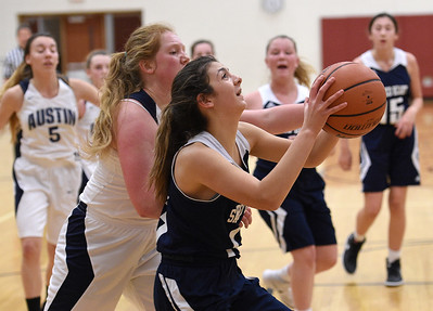 Lola Sheena (23) of Academy of the Sacred Heart puts up a shot during the match between Academy of the Sacred Heart and Austin Catholic on January 23, 2018. THE MACOMB DAILY PHOTO GALLERY BY DAVID DALTON