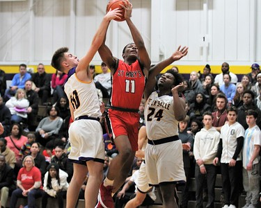 Lorne Bowman ll (11) drives the lane for St. Mary's. Orchard Lake St. Mary defeated De La Salle 60-47 in a game played on January 11, 2019 at De La Salle. Digital First Media photo gallery by George Spiteri.