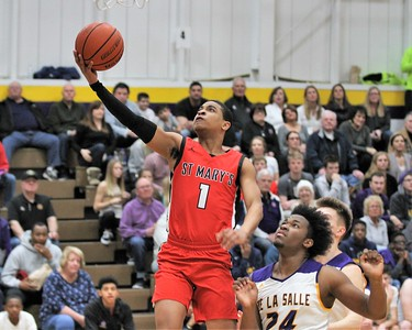 Khalil Rozier goes up to score a basket for St. Mary's. Orchard Lake St. Mary defeated De La Salle 60-47 in a game played on January 11, 2019 at De La Salle. Digital First Media photo gallery by George Spiteri.