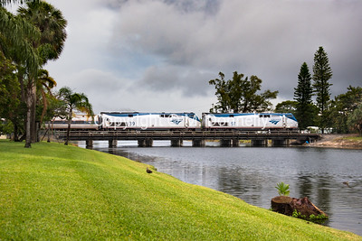 Train 97, with locomotive 97, the Silver Meteor, passes through Pompano Beach, FL amid scattered showers.