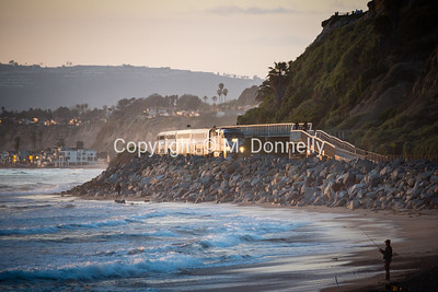 459 rolls through San Clemente at dusk with a Pacific Surfliner.