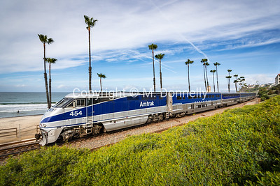 454 and a perfectly matched Pacific Surfliner set roll through San Clemente, CA.